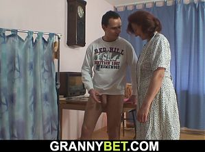Old tailoress takes younger cock from behind