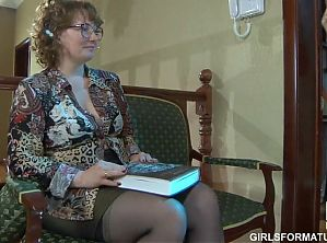 Alana, a Russian mature fucks a young girl with her dildo