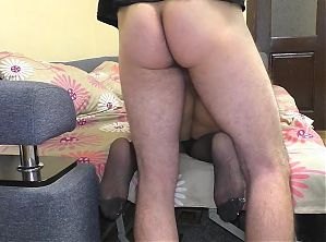 Mom lays down on the sofa and gives a blowjob to her stepson