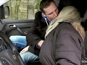 German wife fucks in a car with a hitchhiker boy and gives him a rimjob