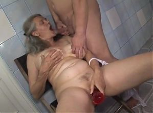Hungarian granny fucked in bathroom by young guy